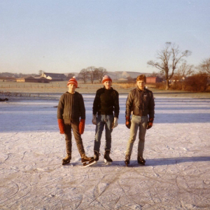 Founding members Gregor and Craig ice skating on a frozen flood at Denny Cemetery in the 1980s.